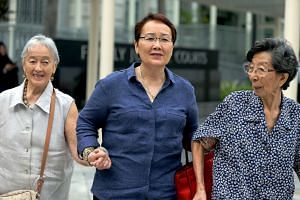 (From left) Widow Chung Khin Chun, her niece Hedy Mok and her good friend Chang Phie Chin arriving at the State Courts on May 30, 2016.