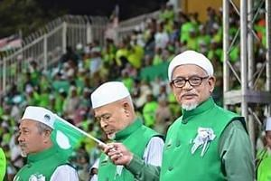 PAS leaders (from left) deputy president Tuan Ibrahim Tuan Man, spiritual leader Haron Din and president Abdul Hadi Awang. Malaysia's Islamic party begins a much-watched annual assembly today, with its leaders trying to restore the faith of members a