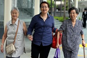 Heading to court yesterday to observe former China tour guide Yang Yin's trial were (from left) Madam Chung Khin Chun, her niece Hedy Mok and family friend Chang Phie Chin. Yang faces 347 charges related to immigration offences and falsification of r