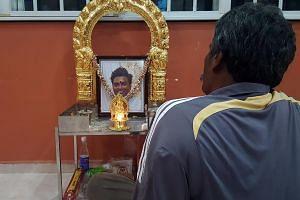 Ramasamy Ramalingam, looks at a photograph of his son, former S-League footballer Sivaneswaran Ramalingam, who was found dead in Bangkok on Saturday (May28).