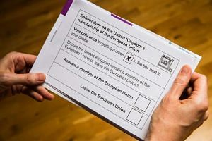 A British national receives her postal ballot paper for the upcoming EU referendum scheduled for June 23rd.