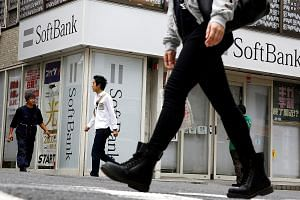 The transactions will cut SoftBank's holding in Alibaba to about 28 per cent from just over 32 per cent.