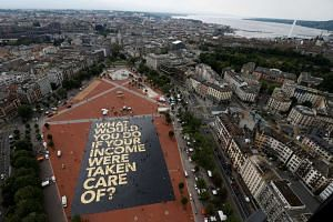 An 8,000 sq m poster is pictured on the Plainpalais square in Geneva, Switzerland on May 14, 2016.