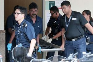 Police officers were seen carrying a body bag out of the toilet at about 4pm yesterday (June 3).