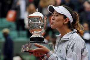 Fourth seed Garbine Muguruza shows her delight at beating top seed Serena Williams 7-5, 6-4 in the French Open final yesterday. The American was denied a chance to equal Steffi Graf's mark of 22 Grand Slam singles titles.