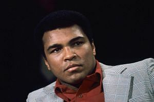 A file photo dated Nov 10, 1975, of US boxer Muhammad Ali as a guest of the German ZDF television sport show Aktuelles Sportstudio in Wiesbaden, Germany.