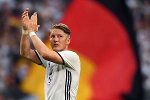Germany's Bastian Schweinsteiger reacts after the match.
