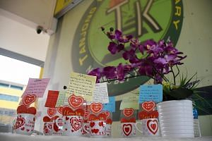 (Left) Messages penned by the sister of victim Navdeep Singh Jaryal Raj Kumar at Tanjong Katong Primary School, which held a memorial ceremony yesterday. (Above) A soccer event for another victim, Ameer, involving some 60 people, including his footba