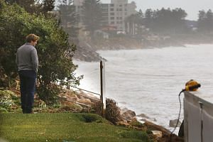 Des Hasler, the coach of the Canterbury-Bankstown Bulldogs rugby league team, looking at the damage caused by heavy rain and storms at Collaroy in Sydney's Northern Beaches, NSW, Australia, on June 6.