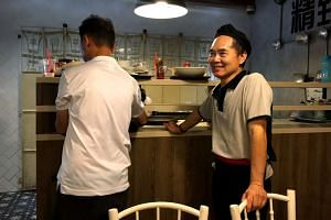 Part-time cleaner Png Lye Heng (right) was the victim of a female patron's tongue lashing after he tried to clear her tray despite her objections.