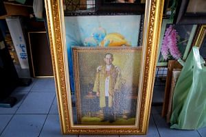A portrait of Thai King Bhumibol Adulyadej at a framing shop in Bangkok, Thailand, on June 7, 2016.