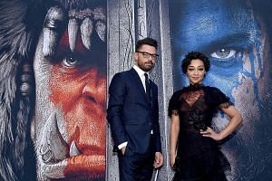 Actors Dominic Cooper and Ruth Negga attend the premiere of Universal Pictures' Warcraft at TCL Chinese Theatre IMAX on June 6, 2016 in Hollywood, California.