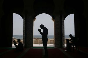 Palestinians pray at the al-Khaldi mosque in Gaza City, on June 8, 2016, on the third day of the Muslim holy month of Ramadan.