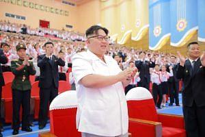 North Korean leader Kim Jong-Un (center) celebrating the 70th founding anniversary of the Korean Children's Union in Pyongyang on June 7.