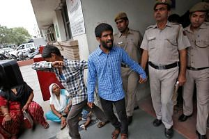 Policemen escort men convicted for the gang rape of a Danish woman, at a court in New Delhi, India, on June 9, 2016.