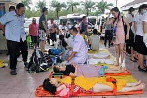 Thai medics attending to tourists after a speedboat crash. Despite MFA warnings about terrorism and accidents in Thailand, many Singaporeans have not been deterred from holidaying there, especially during the current school holidays.