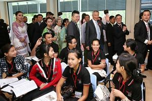 PM Lee touring the campus of the Singapore-Myanmar Vocational Training Institute with Mrs Lee and Mr Ong on the final day of his three-day visit to Myanmar yesterday. The school is modelled on Singapore's ITE.