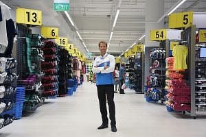 Bastien Grandgeorge, CEO of Decathlon Singapore, standing in his 21,500 sq ft City Square Mall outlet.