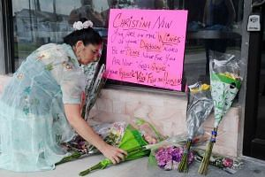 A fan lays flowers at the Plaza Live in memory of singer Christina Grimmie on June 11, 2016.