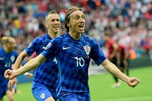 Croatia's Luka Modric (#10) celebrating scoring against Turkey during the Euro 2016 football match at Parc des Princes in Paris on June 12, 2016.
