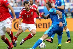 Gareth Bale of Wales (right) in action during the Uefa Euro 2016 match between Wales and Slovakia.