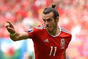 Wales' forward Gareth Bale celebrates after scoring the first goal.