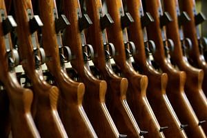 Newly assembled rifles are placed on a stand in a weapons factory in Uhersky Brod, Czech Republic, on May 27, 2016.