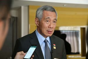 """Prime Minister Lee Hsien Loong wrote that he was """"deeply shocked and saddened"""" by the Orlando shooting."""