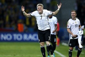 Germany's Bastian Schweinsteiger celebrates after scoring the 2-0 goal during the UEFA Euro 2016 group C preliminary round match between Germany and Ukraine at Stade Pierre Mauroy in Lille Metropole, France, on June 12, 2016.