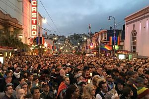People gather in San Francisco's Castro District for a vigil for the victims of the Orlando shooting.