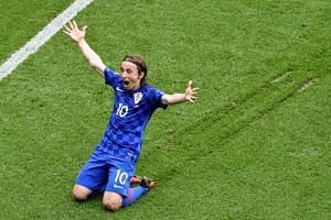 Croatia's midfielder Luka Modric celebrates the team's first goal during the Euro 2016 group D football match between Turkey and Croatia.