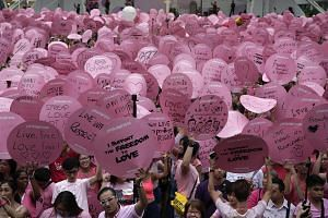 Participants holding up placards with their messages of love and support during the 8th edition of Pink Dot, on June 4.