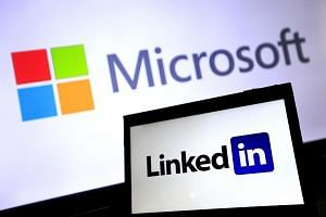 The logos of Microsoft and LinkedIn pictured in Taipei, Taiwan, on June 13. Microsoft has agreed to buy LinkedIn for US$26.2 billion (S$35.6 billion).