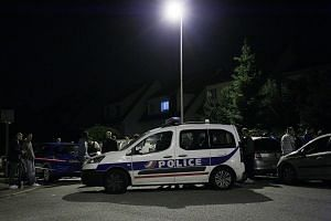 A Police vehicle blocks the road during the hostage situation in Magnanville, Paris, on June 14, 2016.