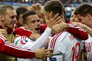 Zoltan Stieber (centre left) of Hungary celebrates with team mates after scoring the 2-0 lead.