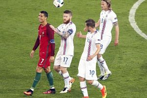 Cristiano Ronaldo (left) of Portugal reacts at the final whistle during the Uefa Euro 2016 group F preliminary round match between Portugal and Iceland.