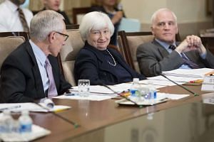 Fed chair Janet Yellen (centre) attends an open meeting of the Board of Governors of the Federal Reserve System.