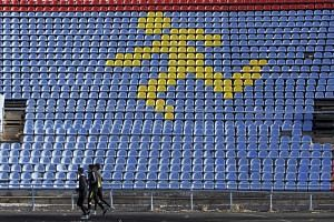 Sportsmen train at a local stadium in the southern city of Stavropol, Russia, on Nov 10, 2015.