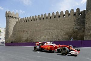 German Formula One driver Sebastian Vettel in action at the first practice session at the Baku city circuit, on June 17, 2016.