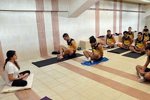 Balestier's new signing Tokic (left-most player) joining his team-mates in a yoga session on Wednesday. He has made an immediate impact, scoring once and notching two assists in two games.