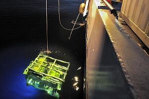 A deep sea robot being lowered into the sea from the search vessel John Lethbridge. The specialist vessel was involved in the recovery of the EgyptAir cockpit voice recorder.