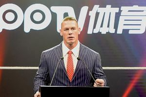 WWE wrestler John Cena speaking at a press conference in Shanghai on June 16, 2016.