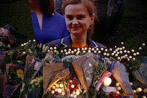 Tributes for slain Labour Party MP Jo Cox are displayed on Parliament Square in London on June 16.