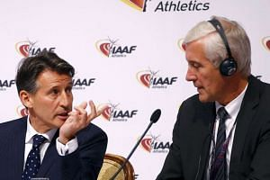 IAAF president Sebastian Coe (left) speaks to Rune Andersen, head of the IAAF taskforce on Russia, during a news conference on June 17, 2016.