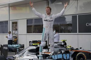 Mercedes Formula One driver Nico Rosberg of Germany celebrates after winning the European Formula One Grand Prix at the Baku City Circuit on June 19, 2016 in Baku.