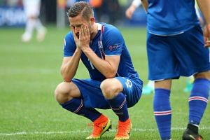 Gylfi Sigurdsson of Iceland reacts at the end of the match.