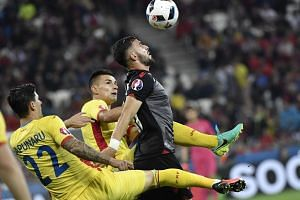 Albania's forward Armando Sadiku (centre) vies for the ball with Romania's defender Cristian Sapunaru (left) and Romania's midfielder Ovidiu Hoban during the Euro 2016 group A football match between Romania and Albania at the Parc Olympique Lyonnais