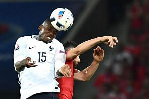France's Paul Pogba (left) vies for the ball against Switzerland's Fabian Schaer during the Euro 2016 group A football match.