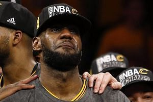 An emotional LeBron James clutching the hard-earned NBA Championship trophy after Cleveland completed the unlikeliest of comebacks to dethrone Golden State in the Finals. The Cavs star was also named the Finals MVP after notching a triple-double in C
