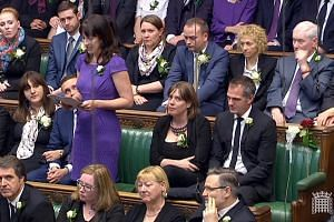 Above: British MPs returned to Parliament yesterday for a special sitting to pay tribute to Mrs Cox, the MP for Batley and Spen constituency.